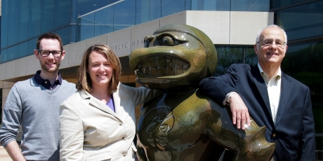 Miles Dietz, Colleen Mitchell and Phil Kutzko with one of the University of Iowa's Herky statues.
